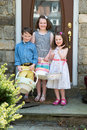 Young Siblings Outside Dressed Up for Easter holding Baskets Royalty Free Stock Photo