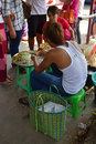 Young single roadside vendor preparing & selling local favorite snacks outside of Bogyoke Market at Yangon, Myanmar Royalty Free Stock Photo