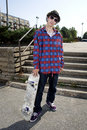 Young skateboarder standing up Royalty Free Stock Image