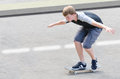 Young skater teenager guy in motion moving on skateboard Royalty Free Stock Photo