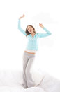 A young and sleepy Caucasian woman stretching Royalty Free Stock Photo