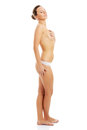 Young slim and beautiful topless woman. Royalty Free Stock Photo
