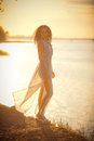 Young and slim a slender girl in a gauzy dress in the sun the serenity beauty Stock Images