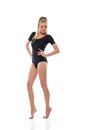 Young slim woman posing in black leotard isolated on white Royalty Free Stock Image