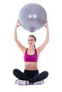 Young slim woman in sports wear sitting with fitness ball isolat isolated on white background Royalty Free Stock Photo