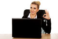 Young smile businesswoman behind the desk, using laptop Royalty Free Stock Photo