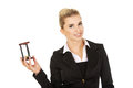 Young smile businesswoman with hourglass - time concept