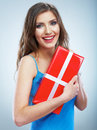 Young smile woman hold red giet box with white ribbon studio background female model Stock Photos