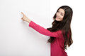 Young smile woman pointing at a blank board standing her finger Royalty Free Stock Photography