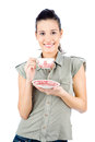 Young smiled girl holding a teapot brunette isolated on white background Royalty Free Stock Image