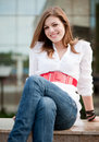 Young smiley woman sitting Royalty Free Stock Photography