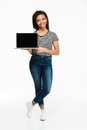 Young smiling african woman standing and holding blank screen laptop Royalty Free Stock Photo