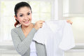 Young smiling asian woman showing white clean clothes Stock Photo