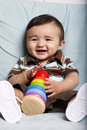 Young smiling baby with toy Royalty Free Stock Photos