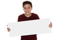 Young smiling boy holding an empty sign with copyspace Royalty Free Stock Photo