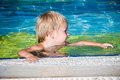 Young smiling boy in the swimming pool Royalty Free Stock Image