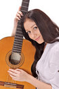 Young smiling brunette with acoustic guitar Royalty Free Stock Photo