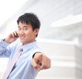Young smiling business man speaking phone Royalty Free Stock Image