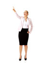 Young smiling business woman pointing for copyspace or something Stock Photo