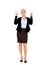 Young smiling business woman pointing up Royalty Free Stock Photos