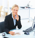 Young smiling business woman sitting Royalty Free Stock Photos