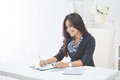 Young smiling business woman working on her paperwork Royalty Free Stock Photo