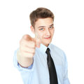 Young smiling businessman pointing finger isolated on white portrait of successful background Stock Photo