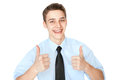 Young smiling businessman showing thumbs up isolated on white portrait of successful background Stock Photo