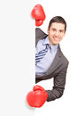 Young smiling businessman wearing boxing gloves Stock Image