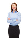 Young smiling businesswoman with crossed arms Royalty Free Stock Photos