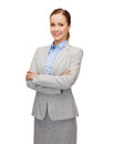 Young smiling businesswoman with crossed arms business and education concept friendly Stock Photos