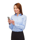 Young smiling businesswoman with smartphone business technology internet and education concept friendly Royalty Free Stock Photos