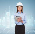 Young smiling businesswoman in white helmet Royalty Free Stock Photo