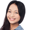 Young smiling chinese woman posing casually Stock Photo