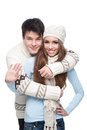 Young smiling couple in winter clothing embracing Stock Images