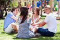 Young smiling couples sitting together Stock Images