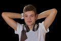 Young smiling dj man with headphones isolated on black Stock Image