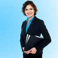 Young smiling female entrepreneur attractive assistant holding files Royalty Free Stock Image