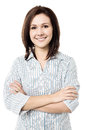 Young smiling female posing confidently attractive with a radiant smile arms crossed Royalty Free Stock Images