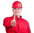 Young smiling fireman with hard hat and uniform Stock Photos
