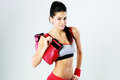 Young smiling fitness woman standing with boxing gloves on gray background Royalty Free Stock Photos