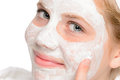 Young smiling girl applying cleaning facial mask treatment beauty Stock Photos