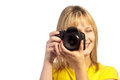Young smiling girl with a dslr camera Royalty Free Stock Photo