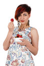 Young smiling girl eating strawberries. Royalty Free Stock Photo