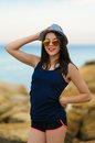 Young smiling girl in grey hat and sun glasses Royalty Free Stock Photo