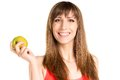Young smiling girl holding green apple in hand. Fitness woman Royalty Free Stock Photo