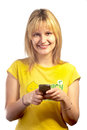 Young smiling girl with a mobile phone Stock Photo