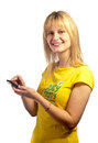 Young smiling girl with a mobile phone Royalty Free Stock Image