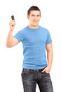 Young smiling guy holding car key Royalty Free Stock Photos