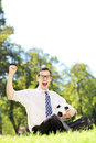 Young smiling man holding a ball and gesturing happiness in the soccer park Royalty Free Stock Photo